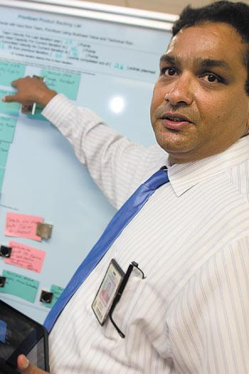 Srini Koushik, Nationwide Insurance's enterprise chief technology officer, designed the application development center around low-tech open communication tools such as a workflow project board.