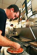 Rising costs piled high at pizza shops