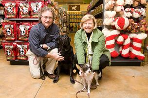 Mike and Trish Elkind are finding a focus on personal relationships with pet owners like themselves – that's Solo, left, and Lilly – is the key to the steady growth of their PetPeople neighborhood pet supply stores in Columbus, Cleveland and Cincinnati. They are shown in the Clintonville store.