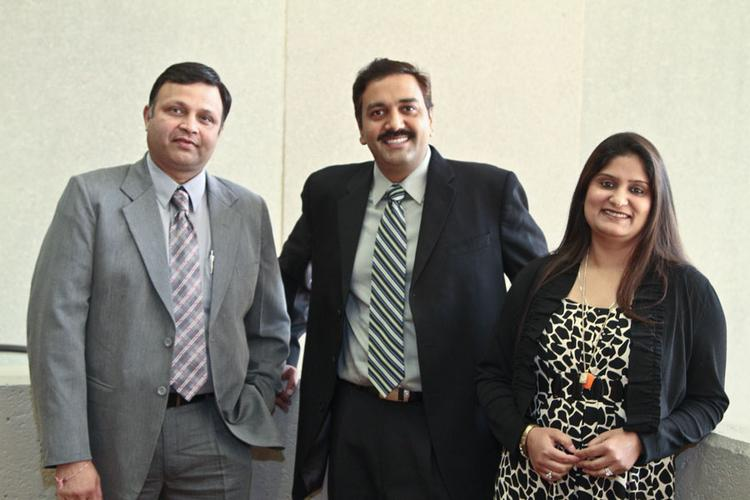 Yashco founders Sheetal and Simren Datta have created a corporate culture that keeps things simple and allows for employee flexibility. They are pictured with Manoj Mohan, vice president, to their left.