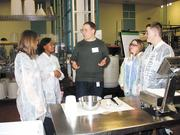 An Abbott employee talks science careers with COSI Academy students.