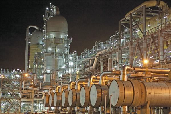 A night photo shows the quench units at a Shell Oil ethylene cracker plant in Singapore. Click on the next image for a wider view of the complex.