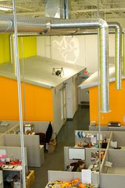 Sudden Impact's office in Westerville  features high ceilings, exposed duct work and a modern color scheme.