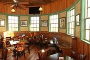 The curved dining room and wooden finishes atBarry's Grill and Pub at Golf Depot.