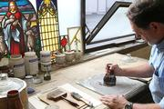 Michael Whapham mixes dye in the stained glass shop, Franklin Art Glass, where he has worked as a designer and glass cutter for nearly 35 years.