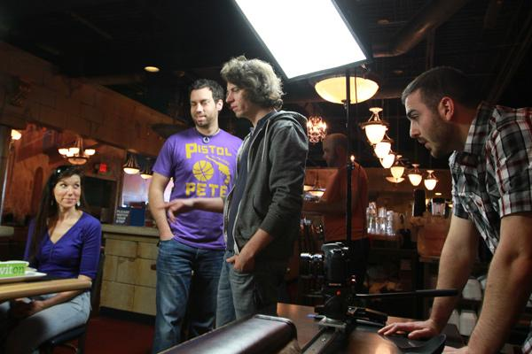 Anthony Trimpe, left, Greg Beck, middle, and Andrew Ina, right, of Longstride work with model Shelly Johnson on a video spot for Giviton, which is a daily deal company that donates to charities. The shoot took place at Big Fat Greek Kuzina.
