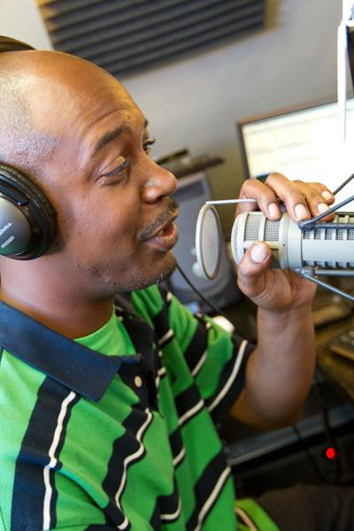 Radio host Marc Pearson runs through lines at TalktainmentRadio.com's studio in downtown Columbus. Click on the next photo to see the men behind the station.