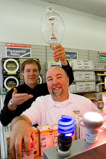 The introduction of light bulbs at Batteries Plus stores, such as the five in Columbus owned by Steve Sutton, foreground, is giving employees such as Product Manager James Eisley new material to learn.