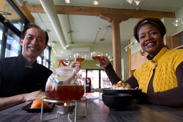 Tea house owner I-Cheng Huang enjoys a cup with Moniqua Spencer, chief program officer of the Finance Fund. ZenCha Tea Salon's third location, on Gay Street, was made possible by a loan from the nonprofit Finance Fund.