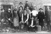 Henry Helf is on the far right at top with fellow employees of the Von Gerichten Art Glass Co. in Columbus. Helf influenced his son, Elmore Helf, to open Franklin Art Glass.