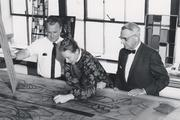 Elmore Helf, founder of Franklin Art Glass, is shown on the right, with his son James Helf at left, in their Sycamore Street studio.