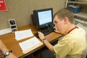 Greg Schostek, who is on the autism spectrum, works in a payroll data entry position at Add in Columbus.