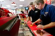 Paul Belle, foreground, is making a franchising push with plans for 20 Firehouse Subs stores locally.