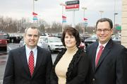 Bill Dawes, left, Mary Beth Culbertson and Bobby Dawes of Bob-Boyd are spending between $500,000 and $1 million in improvements to add the Fiat line to their east-side dealership in a project being overseen by Ricop Construction Co.