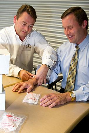 "Dr. David Sybert, left, founded Linebacker LLC, a maker of a low-cost device designed to lock in a catheter and IV line with a hook-and-loop closure. In August, the company hired Jack Kromar, a veteran of Roche Diagnostics, as its CEO. At the time, Sybert said it was time ""to get the business guys involved."""