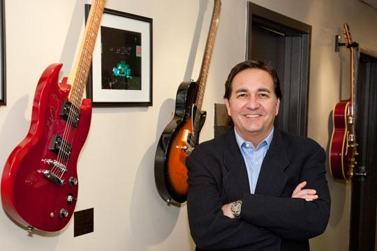 Mark Mizer's guitars that adorn the walls at his company's headquarters are from rock bands such as Foreigner and Charlie Daniels. He brings bands in once a year as part of a customer appreciation event.