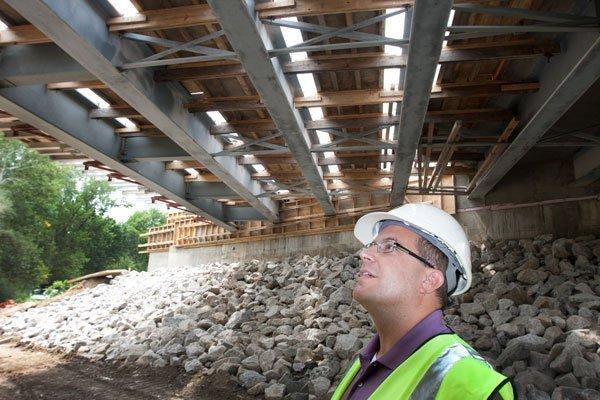 Franklin County Deputy Bridge Engineer James Pajk checks on the progress of the Livingston Avenue bridge that is being reconstructed over Big Walnut Creek.