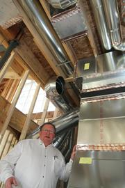 Jeff Reed of Custom Air thinks licensing requirements for HVAC workers should be extended beyond the commercial industry and into the residential side. He's pictured at a new-home construction job in Upper Arlington.
