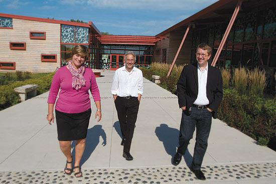 The Grange Insurance Audubon Center uses less than half the energy of a typical building its use and size, which meets the 2030 Challenge toward carbon neutrality. Pictured are Gwen Berlekamp, executive director of the American Institute of Architects Columbus chapter, and local architects involved in the initiative, Keoni Fleming of DesignGroup, middle, and Eric Thompson of NBBJ.