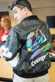 "Damian Synadinos stood out among the first attendees at the reunion, not because at 37 he's younger than the company but because he was wearing a papery-textured windbreaker emblazoned with the CompuServe logo from a 1990s product launch. Synadinos started at CompuServe as an intern while a 19-year-old Ohio State University student and stayed four years, wooed away just before the WorldCom sale. ""Until my current job, it was the longest job I've ever held,"" he said. He moved on to other companies, always a quality assurance tester, making sure software interfaces for consumers weren't buggy before release. Now he's doing that for flight scheduling software at Columbus-based NetJets Inc. ""It's always interesting when you talk to somebody and they worked at CompuServe, too,"" he said."