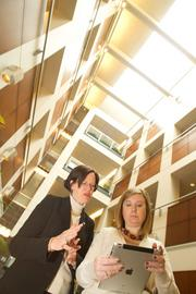 State Auto security chief Nancy Edwards, left, and Social Media Director Katie Peet at the company's downtown Columbus headquarters. Edwards reports to the company's nominating and governance committee at least once a year about information technology risk concerns.