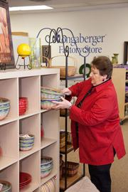 Catherine Pierce is a clerk at Longaberger Factory Store, one of two locations selling retired baskets and home products.