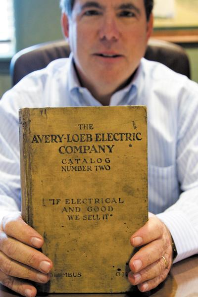 Skip Loeb displays the company's product catalog from 1916.  The third-generation owner is marking the company's 100-year anniversary.