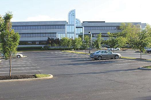 The 400 Metro Place North office building has a new owner.