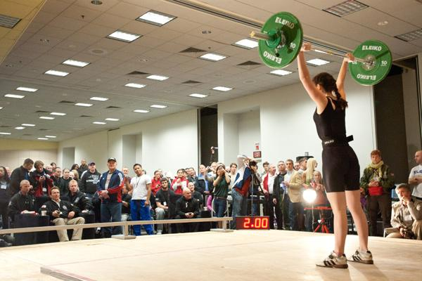 The Arnold Sports Festival will serve as the Olympic qualifier for women's weightlifting this year. Founder Arnold Schwarzenegger, at left, watches the action from last year.
