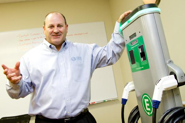 Signature Control President Jon Bowsher shows off the company's latest product offering – electric vehicle charging stations for parking garages, the company's core client base.