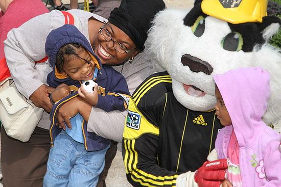 Maileika Young brought her kids to a Columbus Crew rally downtown and had photos taken with team mascot Crew Cat.