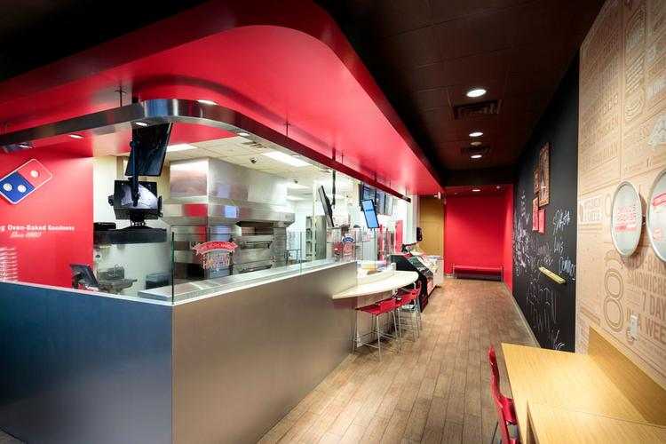 """Chute Gerdeman designed a """"pizza theater"""" look for Domino's."""