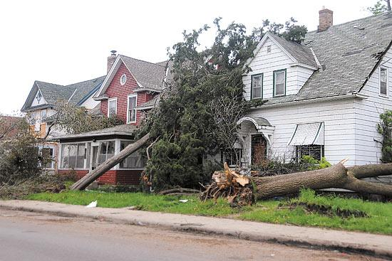 Spring storms, such as the tornado that hit the Minneapolis area, leveled a heavy hit to the bottom lines of insurers including Nationwide Mutual Insurance Co.