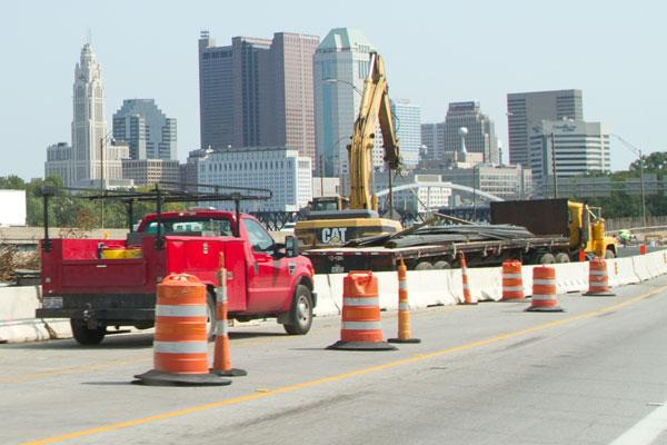 Work continues on the reconstruction of the Interstate 70/71 split downtown, but that could change if federal funding is delayed.