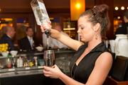 The Ocean Club's liquor license allows bartender Gretchen Wickham to ply her trade.