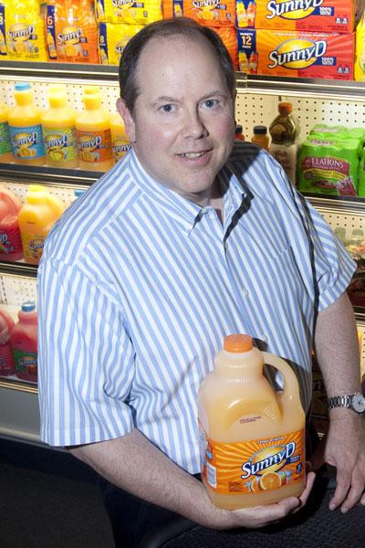 Rick Zimmerman of Sunny Delight shows off the beverage's new container.