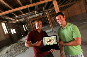 Entrepreneurs Gavin Meyers, left, and Tim Ward are transforming a Short North space into a brew-your-own-beer operation called Bru. The Ohio State grads turned to UFunded to raise money from fellow alumni.