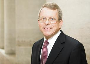 Ohio Attorney General Mike DeWine opposes a bill altering the regulation of payday lending.