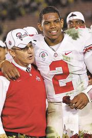 Better times: Former OSU football coach Jim Tressel and quarterback Terrelle Pryor celebrate with Tressel's wife after last year's Rose Bowl victory.
