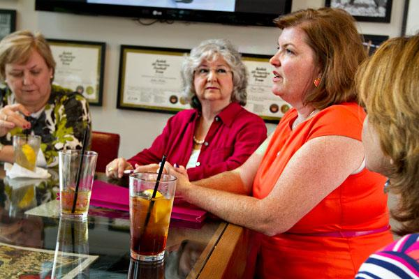 Jeanette Armbrust of Skyline Exhibits, right, finds value in the women she turns to for advice not always going along with her ideas. She regularly meets with other female business owners and executives, including Darla King, left, of King Business Interiors and Lillian Zarzar of ZR Group, middle.