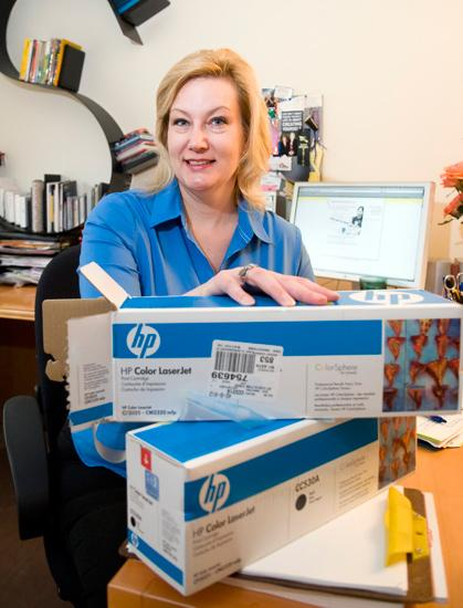 At work, Karen Sullivan takes small steps such as recycling printer cartridges to help care for the environment.