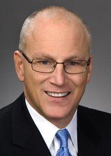 Scott E. Elisar