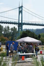An aquaponics workshop group builds a dry system on Portland Purple Water's leased brownfield under the St. Johns Bridge.