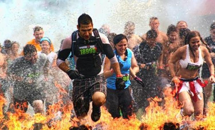 Obstacles included in the Spartan Race are designed based on athletic events throughout history. An example is a jump over a large bonfire.