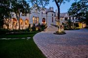 The 15,074-square-foot mansion at 5540 N. 40 Place in North Dallas  sits on 3.29 acres of land, and includes luxe amenities such as outdoor  oasis, multiple gardens, spa and a soccer field. The nine-bedroom, 12-bath home was built by Ventura Custom Homes.