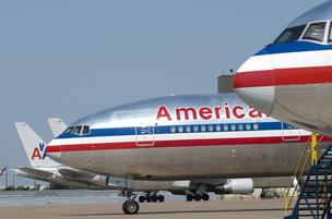 American Airlines said that 2,835 members of the Transport Workers Union have applied for an early-out package.
