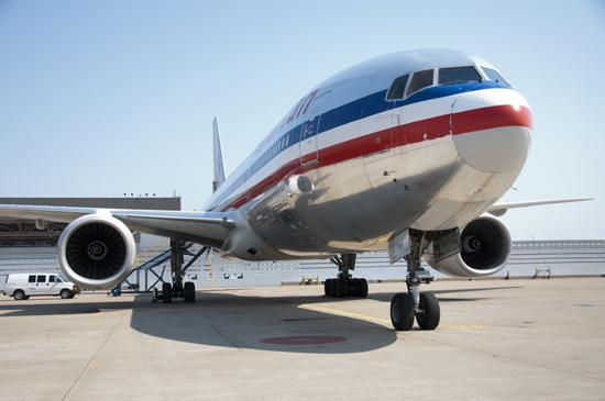 Boeing will speed up production of the 777 model aircraft such as this one at American Airlines' gates at Dallas/Fort Worth International Airport.