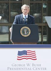 Former President George W. Bush addresses the audience during the dedication of his presidential center Thursday.