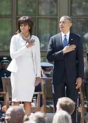 Michelle Obama and President Barack Obama listen to the national anthem Thursday during the dedication ceremony of the George W. Bush Presidential Center at SMU.