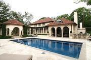 The pool area of Troy Aikman's Highland Park home.